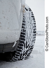 Car With Winter Tires In The Snow