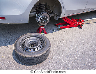 Car without tire on the road ,changing a wheel for car