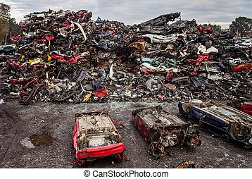 Car wreck on the roof in car scrapyard