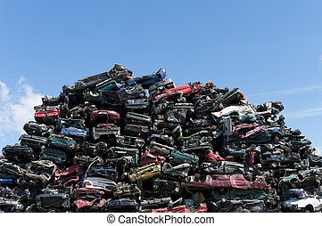 car wrecks - piled up compressed cars going to be shredded
