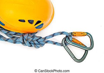 carabiners, orange helmet and rope