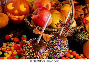 Hand dipped caramel apple covered with multi color sprinkles.