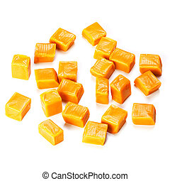 Caramel candy cube isolated on a white background