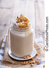 Caramel frappuccino with syrup in mason jar