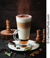 Caramel latte with chocolade on the table