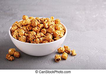 Caramel popcorn in a bowl - Sweet golden caramel flavoured...