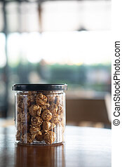 Caramel popcorn in box cups with lid
