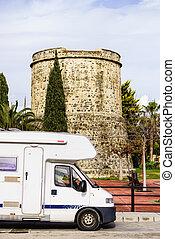 Caravan at old tower, Algarrobo town, Spain