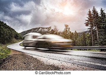 Caravan car trailer travels on the highway. Caravan Car in...