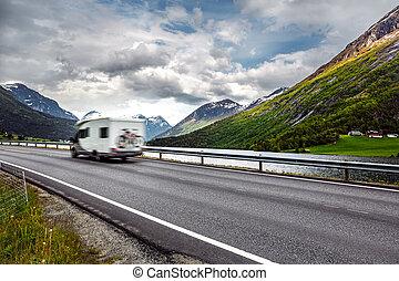 Caravan car travels on the highway. Caravan Car in motion...