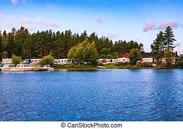 Caravan park camping at the lake in Finland