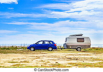 Caravan trailer camping on coast, Spain.