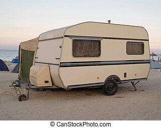 caravan trailer on the beach sunset