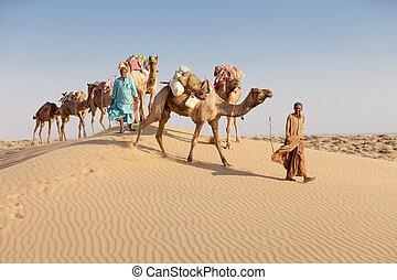 Caravan with bedouins and camels in desert - Caravan with...