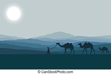 desert - Caravan with camels in desert with mountains on...
