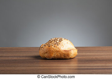 Caraway bread roll on a table