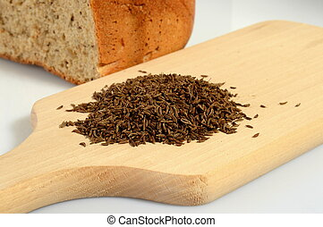 Caraway on a wooden board