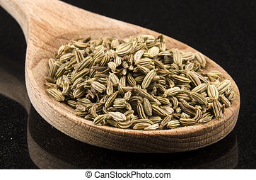 caraway seeds on a kitchen spoon