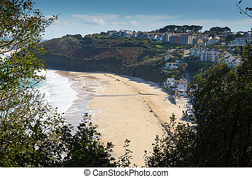 Carbis Bay Cornwall England near St Ives and on the South West Coast Path with a sandy beach and blue sky on a beautiful sunny day