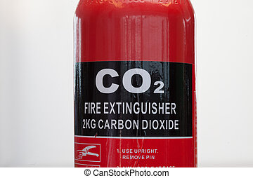 Carbon dioxide fire extinguisher close up - Red carbon...