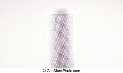 The filter for drinking water filtering a cartridge for system of house water purification on a white background