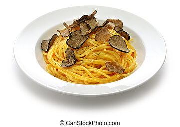 carbonara spaghetti with fresh black truffle isolated on white background