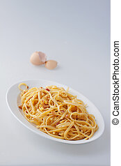 Carbonara - Typical Italian pasta in a white oval plate, ...