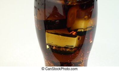 Carbonated drink in a glass with ice. White background -...