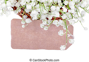card among the lilies of the valley on a white background