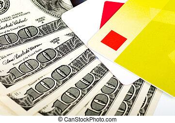 card and dollar bills close