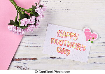 Card, flowers and heart.