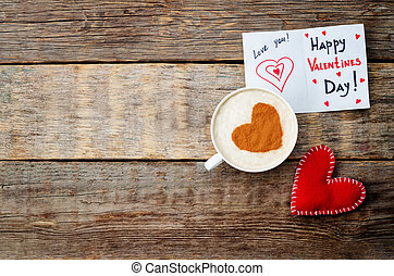 card for Valentines day, red toy heart and a cup of coffee
