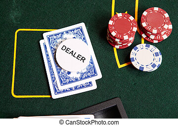 Card gambling - Playing cards, chips and a dealer chip on...