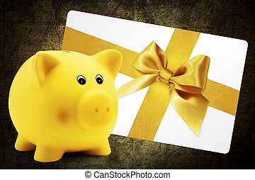 card gift with piggy bank, golden ribbon bow, Isolated on brown background