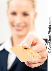Card in hand - Close-up of plastic credit card in ...