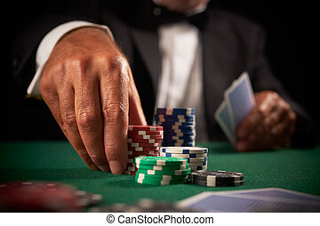 card player gambling casino chips on green felt background...