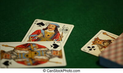 card player throws playing cards
