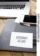 Card saying Attorney at Law on note pad