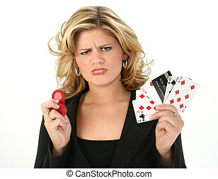 Upset young woman with bad poker hand and credit card. Poker chips in other hand.