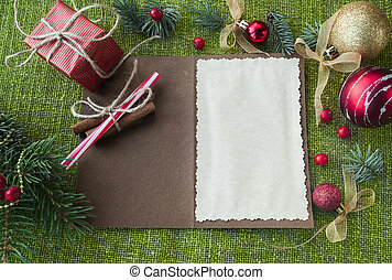 card with Christmas decorations on the table