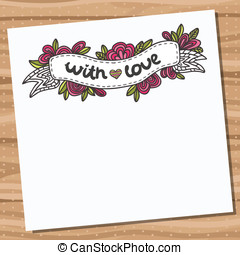 Card with doodle floral ribbon on wooden desk.