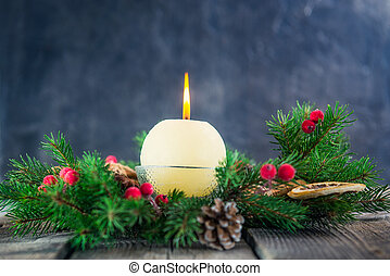 Card with round ivory burning Christmas candle on advent...