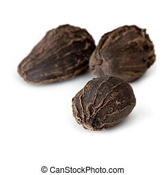 Black cardamom pods, isolated on white. Focus on front pod.