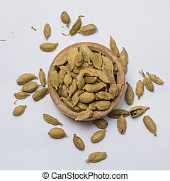 Cardamom - Close-up view of cardamoms on white background.