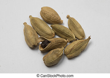 Close-up view of cardamoms on white background.