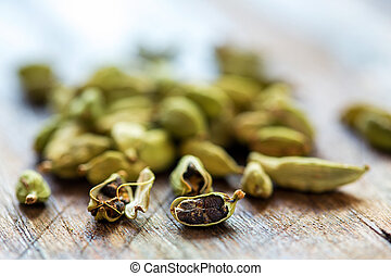 Cardamom closeup. - Green cardamom grains on an old table...