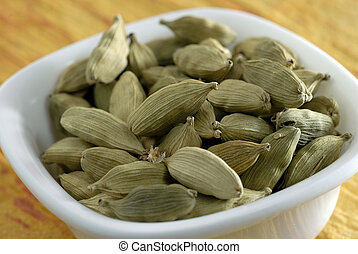 An assortment of green cardamoms used as spices in cooking