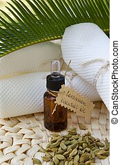 A dropper bottle of cardamom essential oil