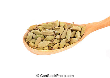 Cardamom pods in wooden spoon, isolated on white background