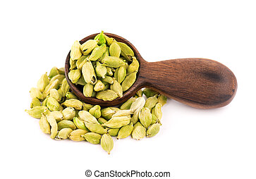 Cardamom seeds in wooden spoon, isolated on white background. Pile of green cardamom pods.